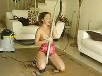 Emily cleaning their house while being naughty