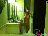 Cute teen takes naked selfie in mirror