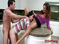 Two hot young ladies fucked a lad in the kitchen