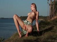 Sensual babe in waterside striptease
