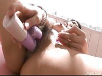 Stunning asian babe banging her wet cunt with a rabbit sex toy