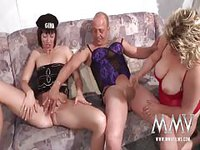 Two mature sluts sucking and fucking a horny old man while he wears women's lingerie