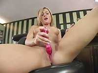 Beautiful barely legal blonde banging her shaved cunt with a toy