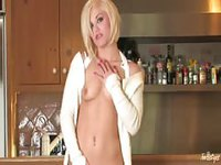 Hot blonde dances for us and touches herself on bar