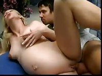 Pregnant blonde pleasures man on blue bed