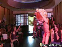 Male stripper in bear mask and his friend in cowboy hat