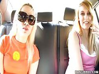 Fun young girls in the car on their way to meet guy in gorilla costume