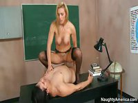 Two teachers decide to get dirty in a classroom