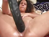 Dark skinned woman with big saggy tits pleasures herself with monster dildo before getting pounded