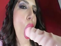 Gorgeous big breasted woman touches herself and sucks dildo