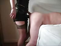 Stunning housewife in lingerie and sexy nylons pegging her willing partner from behind