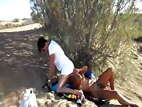 Horny couple enjoying a day at the beach and exchanging oral favors in public