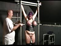 Plump housewife in BDSM restraints with her massive tits turning purple from punishment