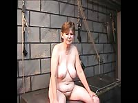 Redhead older tramp exposed and lashed over-and-over again while visiting a BDSM dungeon
