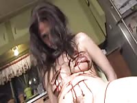 Dark-haired pervert adores cutting herself with a knife