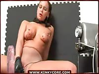 Sexy brown-haired bitch with big boobs enjoys riding on a huge dildo